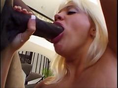 blond mouth drains a huge dark knob