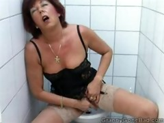 granny rubbing one off in the water closet