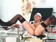 slim milf nurse nora opens cunt with speculum