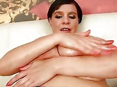 mature laurella playing with her giant bumpers