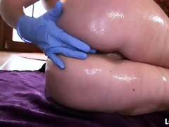 rachel in rubber gloves masturbates her anus.