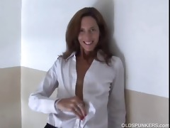 gorgeous aged red head in nylons disrobes and