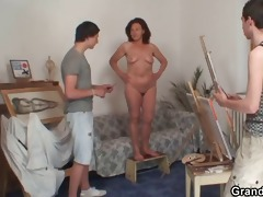 old whore is team-fucked by two youthful painters
