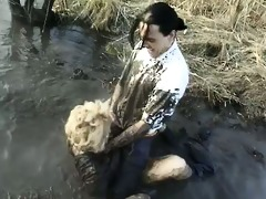 naughty mature housewife overspread with mud