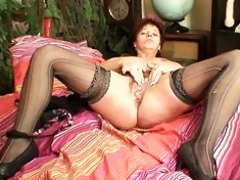 mature non-professional mommy squeezing her muff