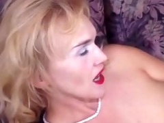 brassy golden-haired granny puts on hose toys and