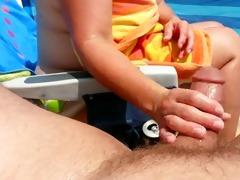 wife does tugjob on beach