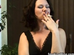 d like to fuck mina puffs on a cigarette