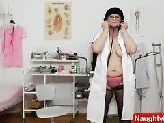 brunette hair practical nurse examining her fur