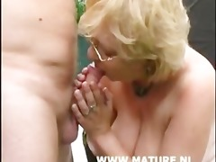 golden-haired older with large boobs and glasses