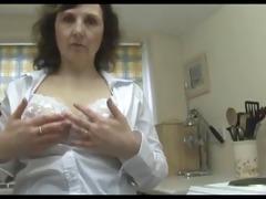 breasty older babe sluggishly undresses down to