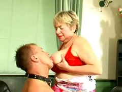 bulky blonde russian granny plays with a younger