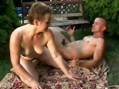 lusty bushy granny enjoying sex with a lad