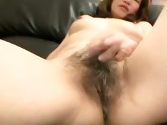 hirsute asian cougar acquires fingered