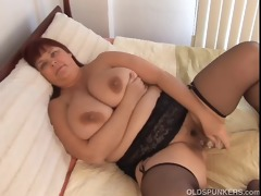 gorgeous breasty milf in nylons works her obese