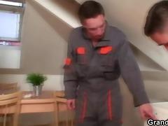 lonely grandma widens legs for two repairmen