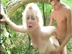 granny sucks two knobs outdoors