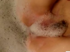 redhead mommy pleasures her soapy pussy