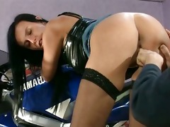 gorgeous dark brown slut climbs on a bike
