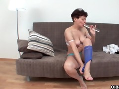 busty granny fucks herself with a glass dildo