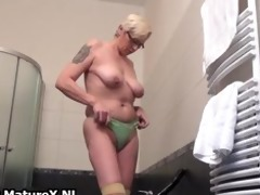 lascivious older woman pulls her belt part1